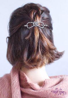 Silver Celtic knot flexi hair clip secures a Dutch braid