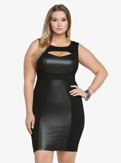 Show off your sexy silhouette in this dynamic black bodycon dress that has a peekaboo cutout above the sweetheart neckline. Contrasting ponte and black faux leather really edge the whole thing up.%0A