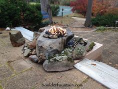 Our Sliding Rock Falls Boulder Fire-Pit Fountain. For more info including video & pricing go to  www.boulderfirepits.com