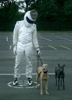 He's not The Stig. He is The Stig's Yorkshire cousin with Whippets, and a cap.