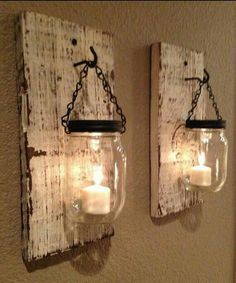Set of 2 antiqued wall mount candle holders. Handmade to order. Includes rustic wood planks, 2 mason jars, chain, and hooks.
