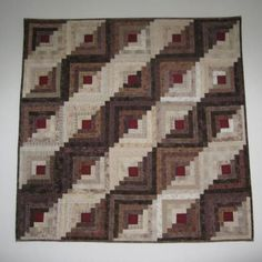 I am in love with this quilt. Japanese taupe log cabin