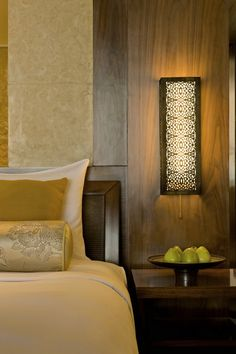 Light at a Hyatt hotel in Goa. Exposed and visible lighting fixtures such as wall sconces, pendants, table lamps, landscape bollards were created to reflect local taste through the use of typical Goan patterns and custom designs.