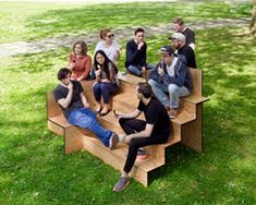 wooden stair public furniture by sebastian marbacher. conceived as a celebration of sitting together in a public space, the stair-like stepped furniture piece encourages social interaction by providing diverse ways of sitting.