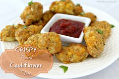 Crispy Baked Cheesy Cauliflower Tots.   AHMazing recipe for healthier tots using cauliflower! I even leave out the cheese and they are still great - or go with cheese for cheesy cauliflower tots. Either way, THIS cauliflower recipe is a WINNER! Every mom and person wanting to make healthier swaps has to have these alternative tater tots in their back pocket. :) Have you tried these yet?