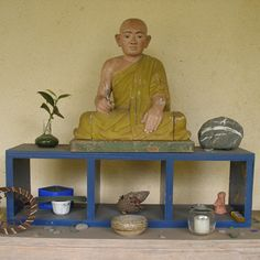 blue buddha plant rock candle altar shrine