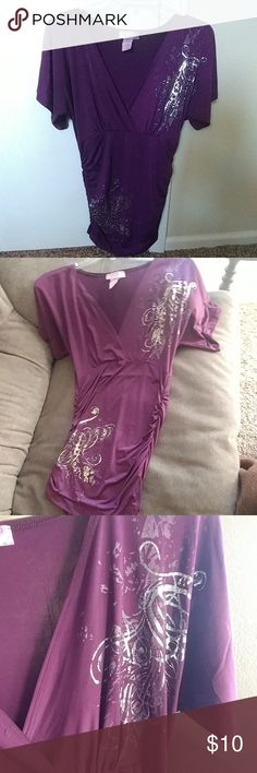 Purple short sleeved tunic Polyester and spandex, low cut, has silver and grey swirl pattern on the top left and bottom right. The sides are scrunched so it stretches a bit. Pinkeli Tops Tunics