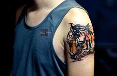 Tattoo Ideen für Männer - Tiger am Oberarm