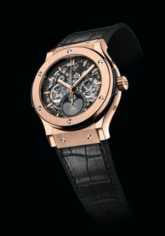 The @hublot Classic Fusion Aeromoon (shown in King Gold) prominently displays the phases of the moon on its skeletonized dial; it holds the HUB 1131, an automatic manufacture caliber, which runs in 25 jewels, vibrates at 28,800 vph and has 134 components - the power reserve is 42 hours. #hublot #watchtime #luxurywatch