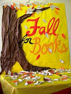 Fall for books.  Extend board backing to table in front.  Scatter leaves with book titles and books.Library Displays