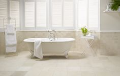A white and cream bathroom featuring Beige Tumbled Marble from Original Style's Earthworks collection.