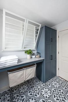 farmhouse laundry room design with blue cabinets and cement tile floor, laundry room decor with folding spsace and storage, farmhouse mudroom design with gray blue cabinets Mudroom Laundry Room, Laundry Room Layouts, Laundry Room Remodel, Laundry Room Organization, Laundry In Bathroom, Laundry Room Cabinets, Blue Cabinets, Master Bathrooms, Shaker Cabinets