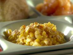 Natina Corn: 2 tablespoons butter, 1/2 cup low-sodium chicken stock, 6 sprigs fresh thyme, 1 (12-ounce) package frozen corn, 1/4 cup sour cream, Salt and freshly ground black pepper, Cayenne pepper, for garnish