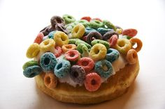 """In honor of """"National Donut Day"""" (don't get me started), we have the mighty Loop doughnut from VooDoo Doughnuts. Just in case you felt you were missing out on your sugar cereal when reaching for that donut - we've got you covered. Also available in Capt'n Crunch (w/ Crunch Berries) and Coco-Puffs! Breakfast of champions."""