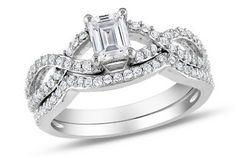 Emerald cut engagement ring & matching wedding band.