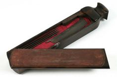 Barber's Razor Box and Hone in Leather Case, England, c1750,  macassar ebony, wood, steel. Wood box contains a cut throat razor and a hone, or sharpening stone. In the 18th century, before the safety razor was invented, a cut throat razor was the only option available to men for shaving purposes. It was normal for men to visit a barber for a shave rather than do it themselves in their own homes. This set, made of macassar ebony, belonged to a man who had a servant to use it for him. BMA