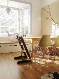 Eames chairs, light, wood & love the baywindow with storage (ikea hack)! Erkerbank met lades.
