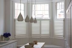 Cafe shutters for bay window in kitchen