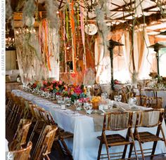 Fun and flirty rustic reception with long tables and ribbons hanging from overhead // Elizabeth Messina Photography // http://www.theknot.com/weddings/album/an-outdoor-wedding-in-los-olivos-ca-63792
