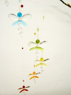 This whimsical rainbow dragonfly mobile has been hand crafted from Swarovski Crystal and glass beads. Does your nursery or childs room require a special something ...?  This is a fun mobile. It has a great sparkle in sunlight and is a great accessory for any room. Place near a window or hang in the middle of the room, this mobile is bound to delight people of all ages. Keep out of reach of babies and children.  Each dragonfly has its own character. They are one of a kind, as they are…