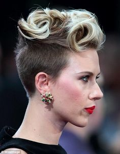 Two-tone: Scarlett went for a punky quiff with her blonde locks, while showing off her darker hair underneath
