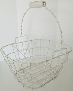 Handy and sturdy white wire basket with a reticulated handle. The handle has a sturdy wooden hand hold. Nice square shape perfect for storage in a bath room or laundry room... #vintage #etsy #vougeteam