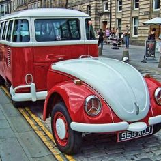Red & white VW bus with a bug trailer