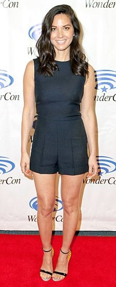 Olivia Munn looks cool and stylish in a Valentino romper and Sophia Webster heels at the Deliver Us From Evil photocall at WonderCon