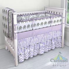 Custom baby bedding in Gray Traditions Damask, White and Gray Elephants, Solid Lilac, Lilac Osborne Damask, Lilac Twirly, Lilac and White Zig Zag. Created using the Nursery Designer® by Carousel Designs where you mix and match from hundreds of fabrics to create your own unique crib bedding. #carouseldesigns