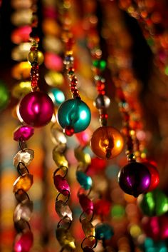 Colored Glass - reminds me of the days when we hung beads like this from the ceiling.