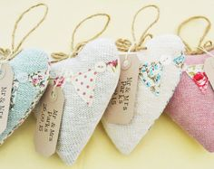 These knitted hearts make a great keepsake for your guests to take home and keep to give them a lasting memento of your special day.  Perfect for an English country garden themed wedding! .Hearts. Sold in a set of 10 these padded hearts are handmade to order each with a knitted front and a fabric back. The fronts of the hearts have been decorated with appliquéd bunting and button details. Each set will contain a mixed selection of fabrics/colours all in a shabby chic style. As the favours…