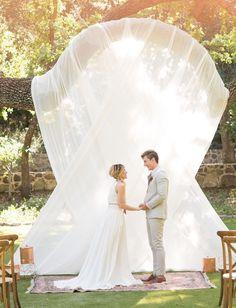 Draped wedding backdrop / http://www.deerpearlflowers.com/wedding-backdrop-ideas-from-pinterest/2/