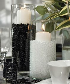 Black and White Candle Wedding Centerpieces - http://simpleweddingstuff.blogspot.com/2013/12/black-and-white-wedding-centerpieces.html