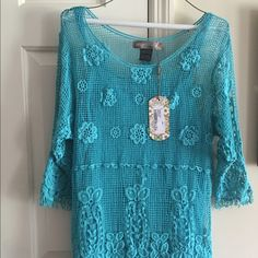 This is still available but for a short time! Beautiful never worn top new with tag. Gift to my daughter but not hr style. Urban Mango Tops
