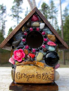 adorable tiny birdhouse made with stones, wine cork, and other recycled materials. eee!!
