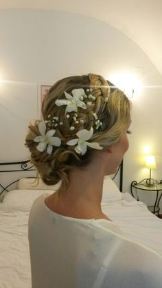 Flowers in the hair,  wedding hairstyles , curly bun on one side , hairstyles for long hair