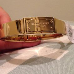 Michael Kors Gold Plaque Bracelet Absolutely gorgeous MK bracelet. Solid gold tone with logo plaque. Shiny and new!! Gold-ion plated steel. Hinge clasp, approx 2-2.5 in diameter. Looks so elegant and classy  Michael Kors Jewelry Bracelets