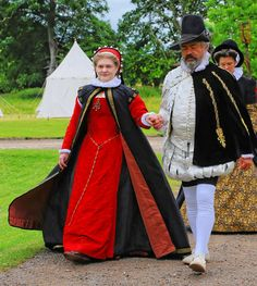 The splendid costumes of the visiting gentry: Lord and Lady Windsor of Bradenham.