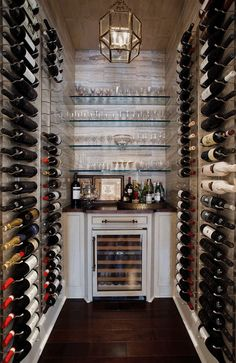Suzie: Woodlands Lifestyles & Homes - Wine room with glass cage pendant chandelier,  wine ...