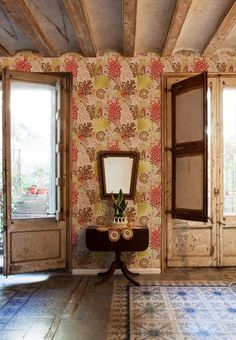 Large-print-floral-wallpaper-Catalina-Estrada-love all the textures coming together on this, doors, floor, etc