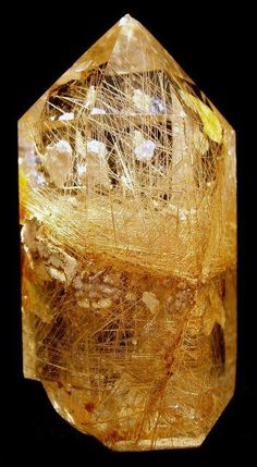 Quartz with needle-like rutile inclusions.  Rutile is a titatium mineral.