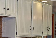 planed cabinet doors and added beadboard and frame to cover cathedral style