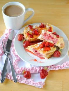 "Strawberries and Cream French Toast | Adapted From : The Foodess | And if ""Strawberry Mascarpone Stuffed French Toast"" doesn't sound tasty to you, the photos on The Foodess' blog should surely LOOK tasty to you.  They did to me, especially on a day when I had picked up a few quarts of berries at a You-Pick farm and some fresh-baked challah at a bakery. 