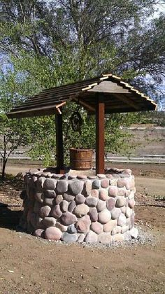A Do-It-Yourself garden stone wishing well brings many decorative possibilities…. A Do-It-Yourself garden stone wishing well brings many decorative possibilities. Useful for creating a koi pond, a flower well, or tool shed. Diy Garden, Lawn And Garden, Garden Projects, Garden Pots, Home And Garden, Wood Projects, Wishing Well Garden, Diy Bird Feeder, Water Features In The Garden