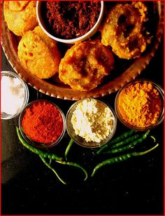 Bateta vada -  indian spices mixed with potato mash patty coated with chick pea flour, then deep-fried and served hot with variety of Dhana, Marchi chutney