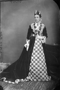 "A woman identified as Mrs. Ritchie wearing a splendid ""chess game"" costume, March 1876."