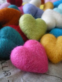 """lil fish studios: Needle Felted Hearts. No instructions but I love the shape of these hearts - much more """"puffy"""" than you can get with regular felting. Something to try and duplicate"""