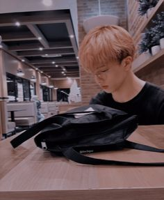 handsome jisung waiting for you at a coffee shop.