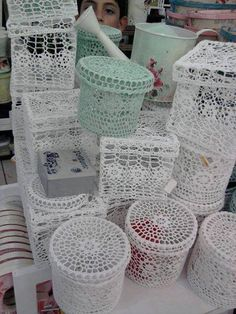 Crochet boxes. Looks like bird cages!