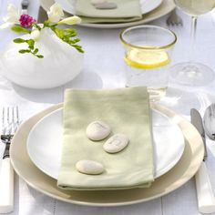 Initialled pebbles make for elegant, fuss-free place settings